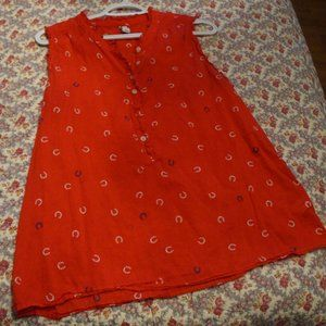 Red Tank With White Horseshoes